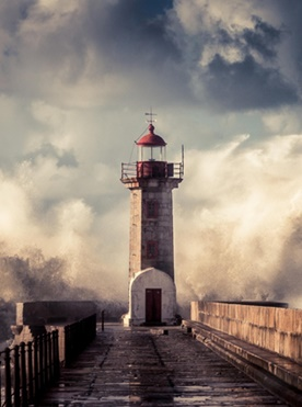 lighthouse-in-storm-ocean-waves-sunset-cloud